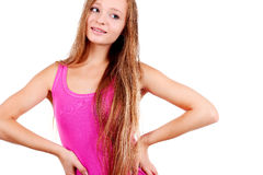 Smiling young blonde woman in pink shirt Stock Photo