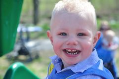 Smiling young boy. In a park setting Stock Photography