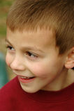 Smiling Young Boy. Close-up of a smiling young, caucasian boy Royalty Free Stock Photography