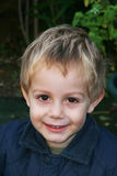 Smiling young boy. Close up of happy young boy with blond hair Stock Photography