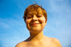 Smiling young boy at the beach Stock Photo
