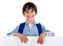 Smiling young boy behind the blank board. On isolated white background Stock Photos
