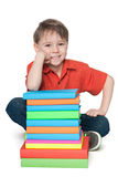 Smiling young boy with books Stock Photos