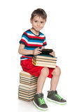 Smiling young boy with a gadget Stock Photo