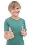 Smiling young boy with a green shirt Royalty Free Stock Images