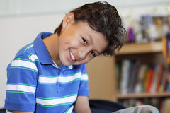 Smiling young boy. With hair gel - with shallow depth of field Royalty Free Stock Photo