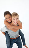 A smiling young boy is on his back a beautiful gir. L Stock Photo
