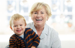 Smiling young boy and his grandmother Stock Photos