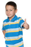 Smiling young boy holds his thumb up Stock Photography