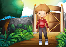 A smiling young boy inside the gated yard Stock Image