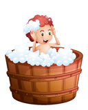 A smiling young boy inside the wooden bathtub Royalty Free Stock Photography