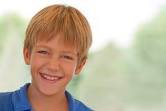 Smiling young boy outdoors Stock Photos