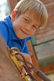 Smiling young boy on the playground Royalty Free Stock Image