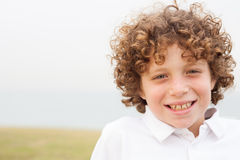 Smiling young boy posing Royalty Free Stock Image