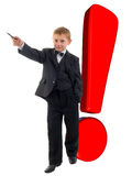 Smiling Young Boy And Red Exclamation Mark. Stock Photography