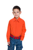 Smiling young boy in a red shirt Stock Images