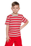 Smiling young boy in red Stock Photos