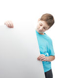 Smiling young boy with a sheet of paper Stock Photography