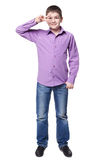 Smiling young boy in shirt and jeans full lenght Stock Photo