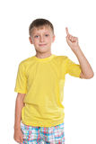 Smiling young boy shows his finger up Stock Images