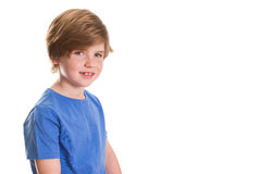 Smiling. Young boy sitting and smiling at the camera with lots of copy space Stock Photos