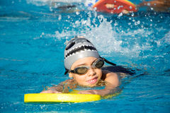 A smiling young boy in swimming pool Stock Images