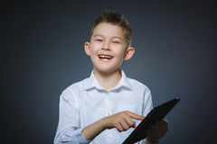 Smiling young boy or teenager with tablet pc computer. Technology, lifestyle, music and people concept - smiling young boy or teenager with tablet pc computer Royalty Free Stock Image
