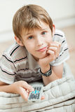 Smiling young boy watching television at home Royalty Free Stock Photo