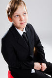 Smiling young boy wearing black suit Royalty Free Stock Photo