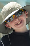 Smiling young boy wearing a hat. Smiling young boy wearing a hat at the beach Stock Image