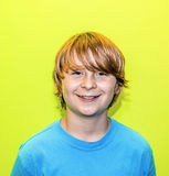 Smiling young boy with yellow wall. Happy smiling young boy with yellow wall Stock Photos