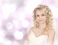 Smiling Young Bride On Light Bokeh Background. Stock Photography