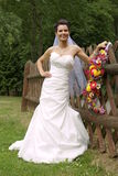 Smiling young bride poses Royalty Free Stock Photos
