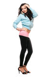 Smiling young brunette in a black leggings Royalty Free Stock Photo