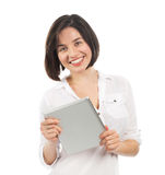 Smiling young brunette holding a touchpad Royalty Free Stock Image