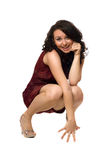 Smiling young brunette in red dress Royalty Free Stock Photography