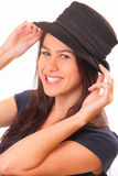 Smiling young brunette woman in a hat Royalty Free Stock Image