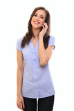 Smiling young brunette woman talking on cellphone Royalty Free Stock Photo