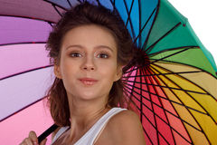 Smiling young brunette woman in white blouse with umbrella stock images