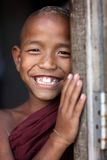 Smiling young Buddhist novice in Mandalay, Myanmar Royalty Free Stock Photo