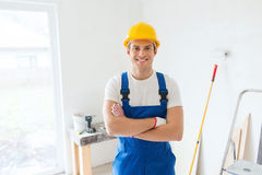 Smiling young builder in hardhat  indoors Stock Image