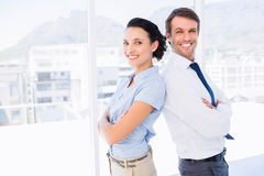 Smiling young business couple with arms crossed Stock Photo
