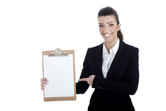 Smiling young business lady pointing Royalty Free Stock Photo