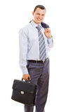 Smiling young business man with case Stock Image