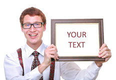 Smiling young business man with a frame. Isolated young business man smiling and holding a blank frame Stock Photography