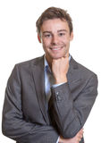 Smiling young business man. Handsome young business man smiling to the camera on a white background Stock Photos