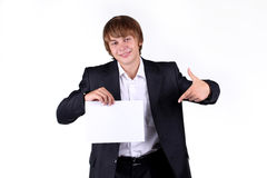 Smiling young business man holding blank. Portrait of a smiling young business man holding a blank billboard, hand Stock Photography