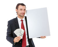 Smiling young business man holding a placard Royalty Free Stock Photo