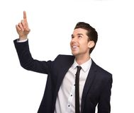 Smiling young business man pointing finger Royalty Free Stock Photos