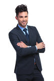 Smiling young business man standing with arms folded Stock Photography